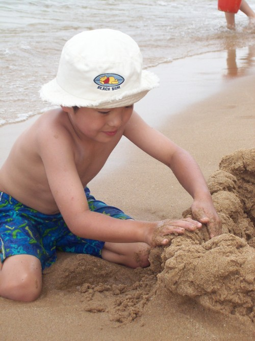 Building sand castles on the beach